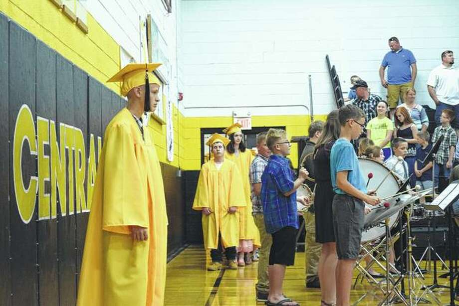 Members of the 2017 class at A-C Central Middle School file into the Pete Gutmann Memorial Gymnasium in Ashland Thursday night for graduation ceremonies. Photo: Greg Olson | Journal-Courier