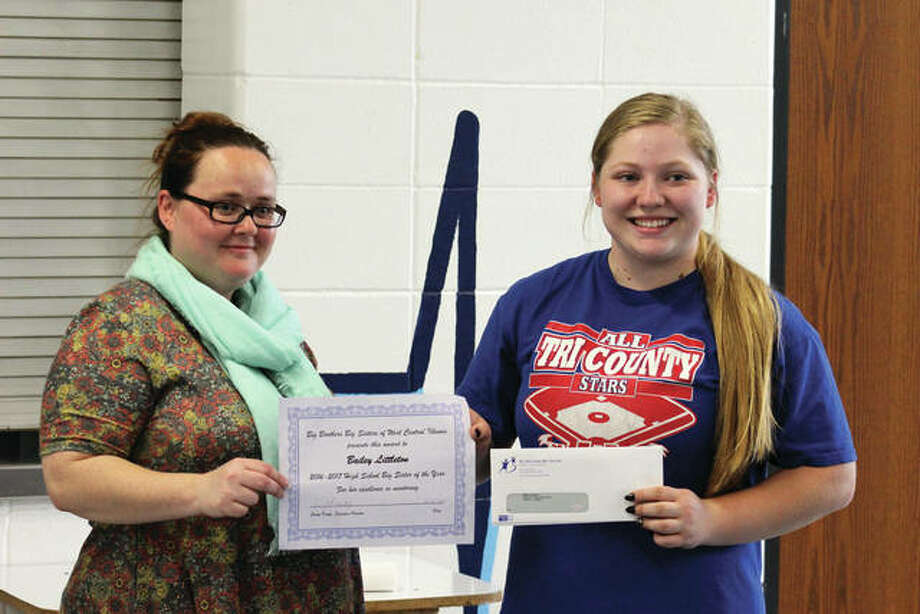 Big Brothers Big Sisters of West Central Illinois recently honored Triopia Junior-Senior High School student Bailey Littleton (right) as its Big Sister of the Year. Program director Andrea Murray presented Bailey with the award, which includes a certificate and a scholarship and recognizes Bailey for excellence in mentoring. Photo: Photo Provided