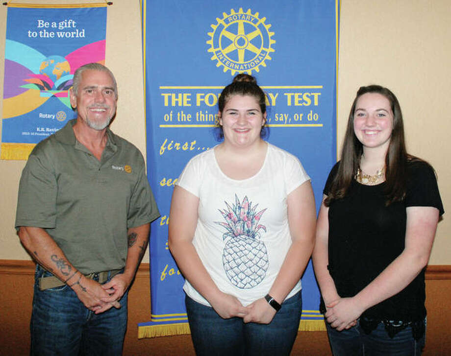 Rushville Rotarian Dan Adams stands with Rotary Youth Leadership Awards graduates Emily Canter and Kaytlin Schieber, both sophomores at Rushville-Industry High School. RYLA is a leadership weekend attended by Rotary youth from schools throughout western Illinois. Rushville Rotary sponsored Emily and Kaytlin. Photo: Photo Provided