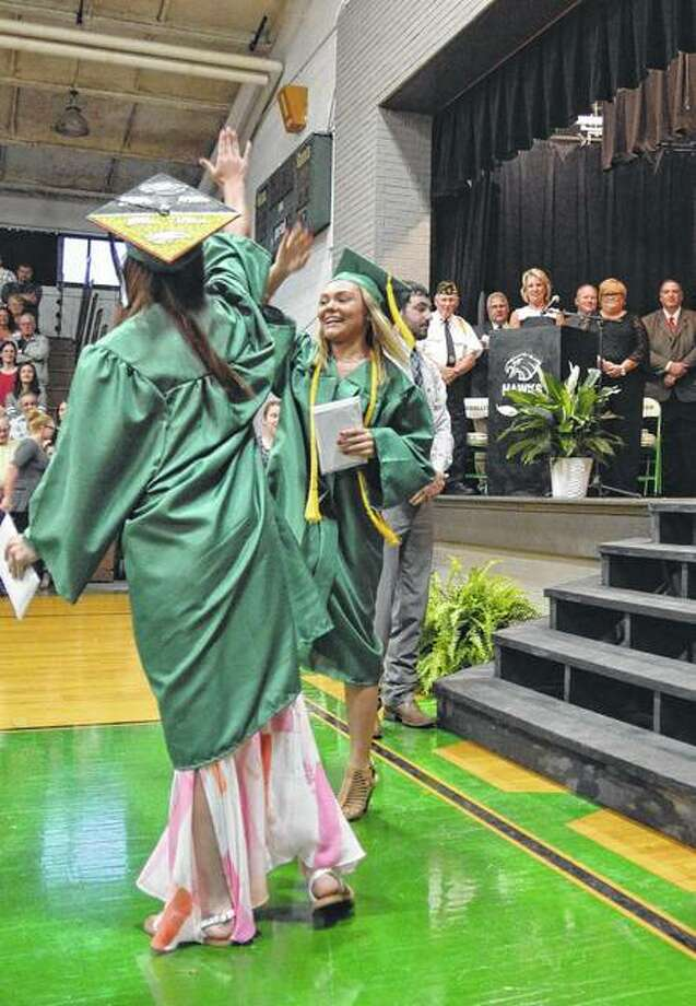 "Emma Curtner gives a high-five and dances off stage to the Backstreet Boys' ""Everybody"" at the end of Carrollton High School's graduation. Photo: Kathleen Clark 