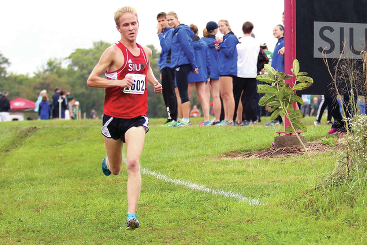 Keith Meyer of SIUE leads the pack on his way to winning the men's race at the John Flamer Invitational Saturday at SIUE.