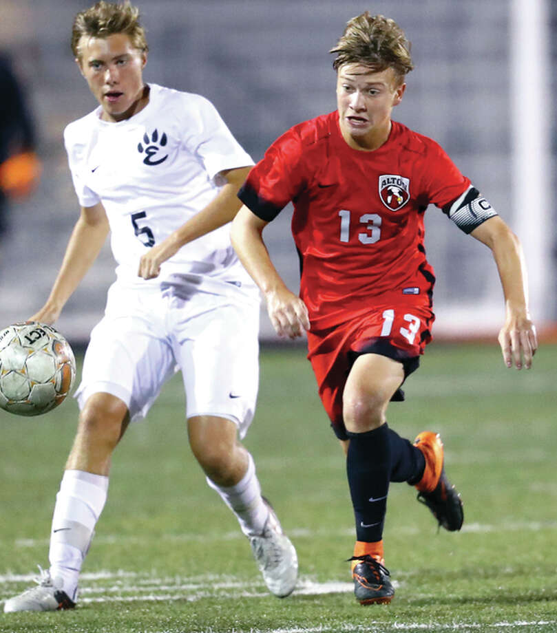 Alton's Skylar Funk (3) scored the only goal of the game in Saturday's 1-0 victyory over Wterloo Gibault at Alton. Funk is shown in action last week against Edwardsville's Jacob Mulvihill. Photo: Billy Hurst File Photo | For The Telegraph