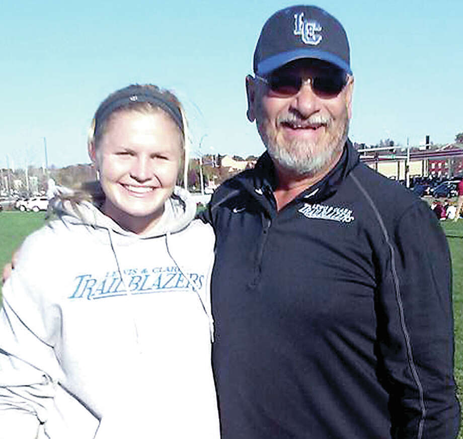 Lewis and Clark goalie coach Brian Korbesmeyer shares a laugh with LC goalie Natalie Otten. Korbesmeyer, is in his second stint at LC, with 14 years as head women's soccer coach at SIUE in between. He has said this is his final season as a coach. Photo: File Photo