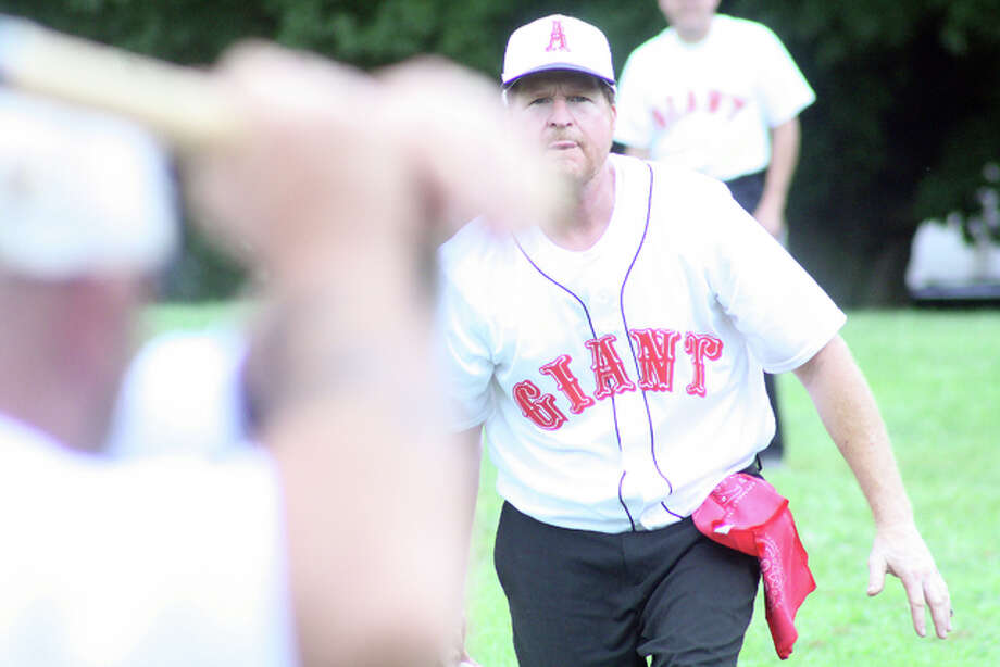 "Alton Giant hurler ""Red"" tosses a pitch during a vintage base ball game earlier this summer at Rock Spring Park."