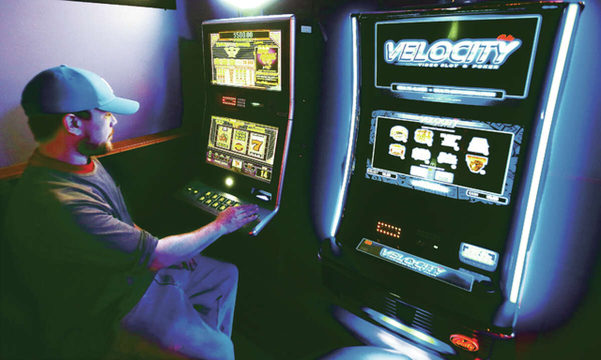 An Alton man tries his hand at a video slot machine this week at Bubby and Sissy's bar at 602 Belle Street in Alton.