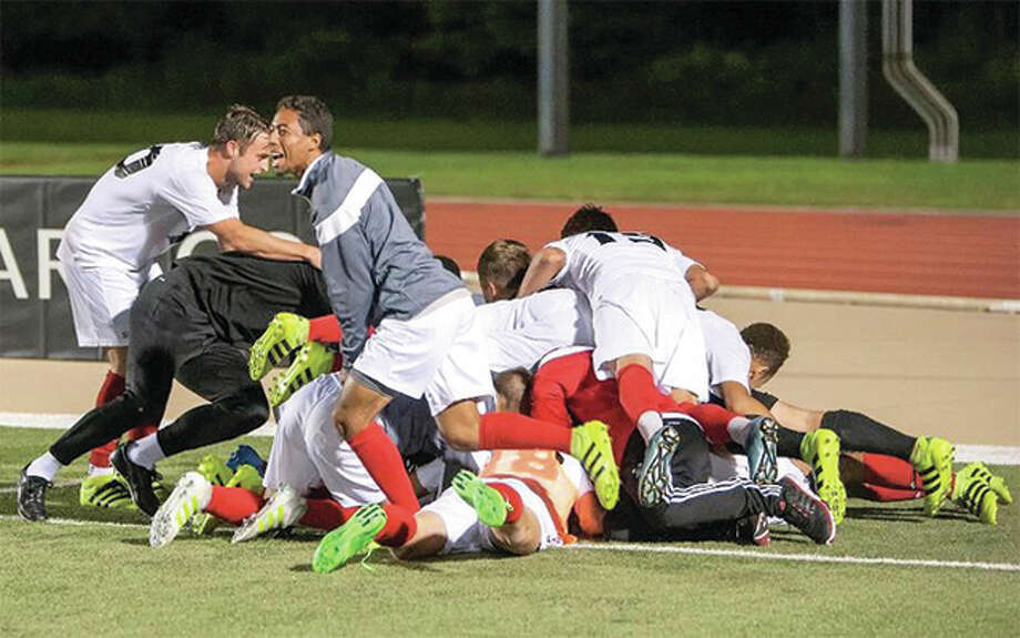The SIUE Cougars pile on teammate Lachlan McLean after his goal in overtime gave SIUE at 2-1 victory over Drake on Homecoming Saturday night at Korte Stadium in Edwardsville. Photo: SIUE Athletics