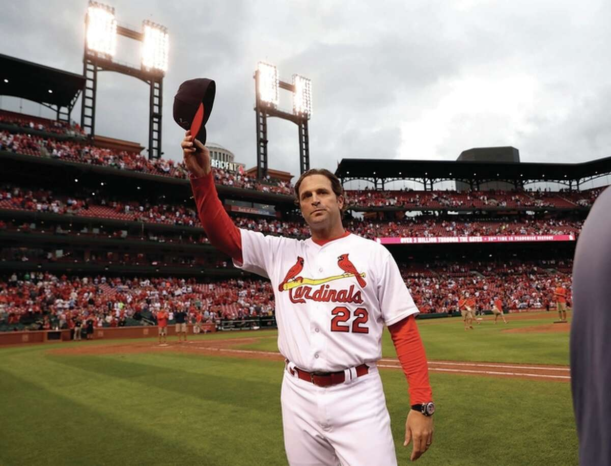 Cardinals manager Mike Matheny tips his cap to the fans following a 10-4 victory over the Pittsburgh Pirates on Sunday at Busch Stadium in St. Louis. The Cardinals were eliminated from playoff contention after the San Francisco Giants defeated the Los Angeles Dodgers to earn the final National League Wild Card spot.