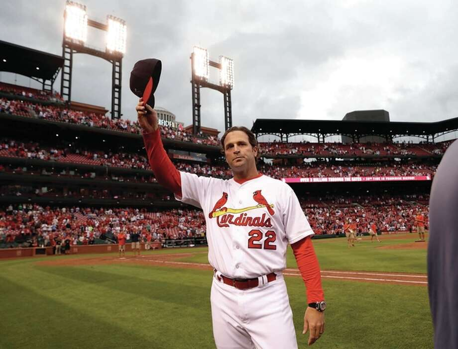 Cardinals manager Mike Matheny tips his cap to the fans following a 10-4 victory over the Pittsburgh Pirates on Sunday at Busch Stadium in St. Louis. The Cardinals were eliminated from playoff contention after the San Francisco Giants defeated the Los Angeles Dodgers to earn the final National League Wild Card spot. Photo: Associated Press