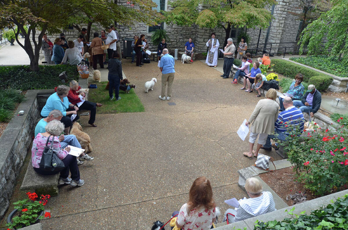 Several people and their animals from all over the Riverbend gathered Sunday for the annual Blessing of the Animals service held in the Episcopal Parish of Alton's courtyard.