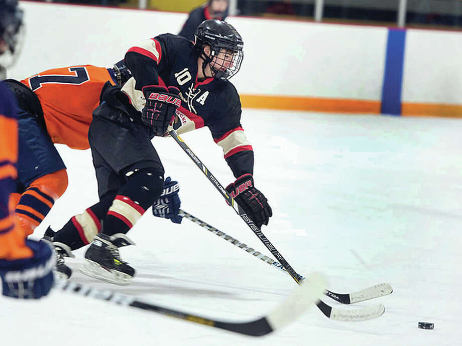 SIUE's Nick Edwards (10) scored a pair of goals for the Cougars over the weekend in their home openers at the East Alton Ice Arena. SIUE beat Missouri 6-3 Friday, but fell 5-4 Saturday. Photo: Telegraph File Photo