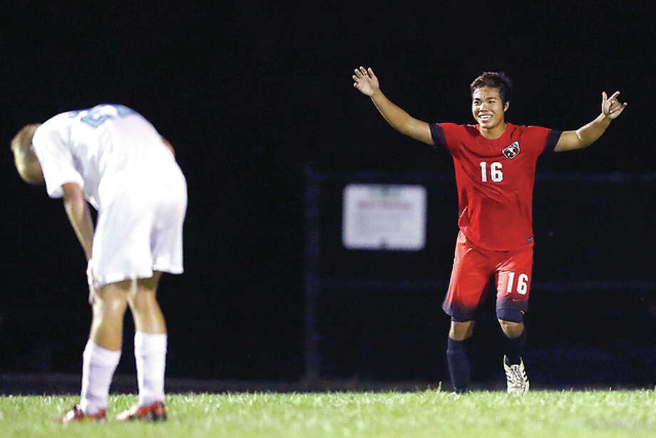 Alton's Steven Nguyen, right, celebrates after scoring a goal as Jersey's Drake Blackwell reacts in dejection during Monday's match played in Jerseyville. Photo: Billy Hurst | For The Telegraph