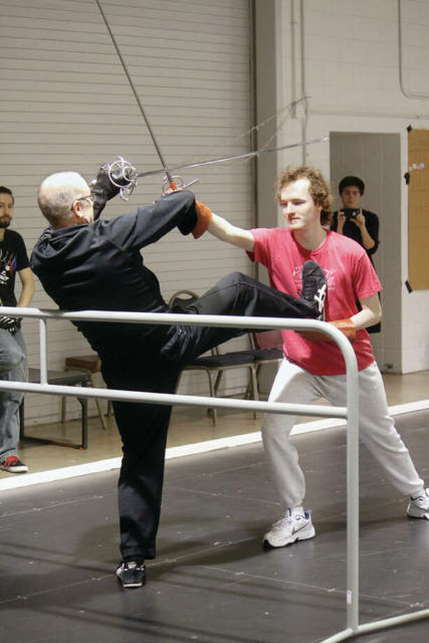 "Mark Hardiman (left), a theater professor at Lincoln Land Community College in Springfield, teaches stage combat with Allen Schmitz during a class in April at LLCC. Several students from Hardiman's class are now cast members in ""The Three Musketeers,"" a play Hardiman is directing at Lincoln's New Salem State Historic Site's Theatre in the Park in Petersburg. The play, which opened last weekend, finishes its run this weekend with shows at 8 p.m. today through Saturday. Tickets, which are $15 for adults, $13 for seniors and $10 for children under age 12, are available online at theatreinthepark.net or by calling 217-632-5440. Photo: Submitted Photo"