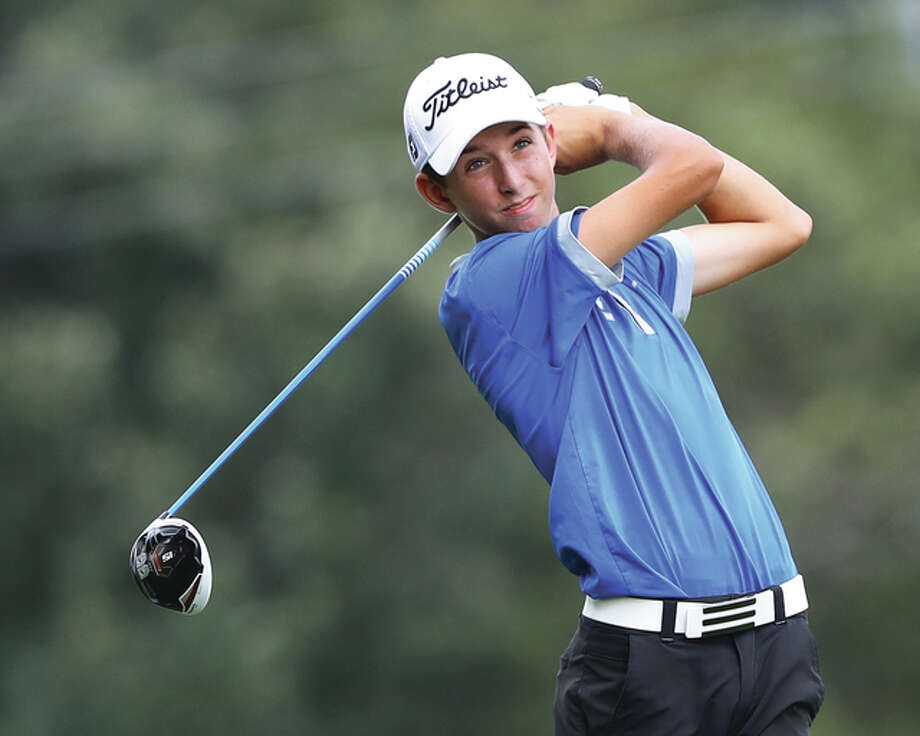 Marquette Catholic sophomore Kolten Bauer hits a shot during the Madison County Tournament on Aug. 18 at Belk Park in Wood River. Bauer was back at Belk on Tuesday and led all golfers with a 2-under par 70 to led the Explorers to the championship of the Roxana Class 2A Regional. Photo: Billy Hurst / For The Telegraph