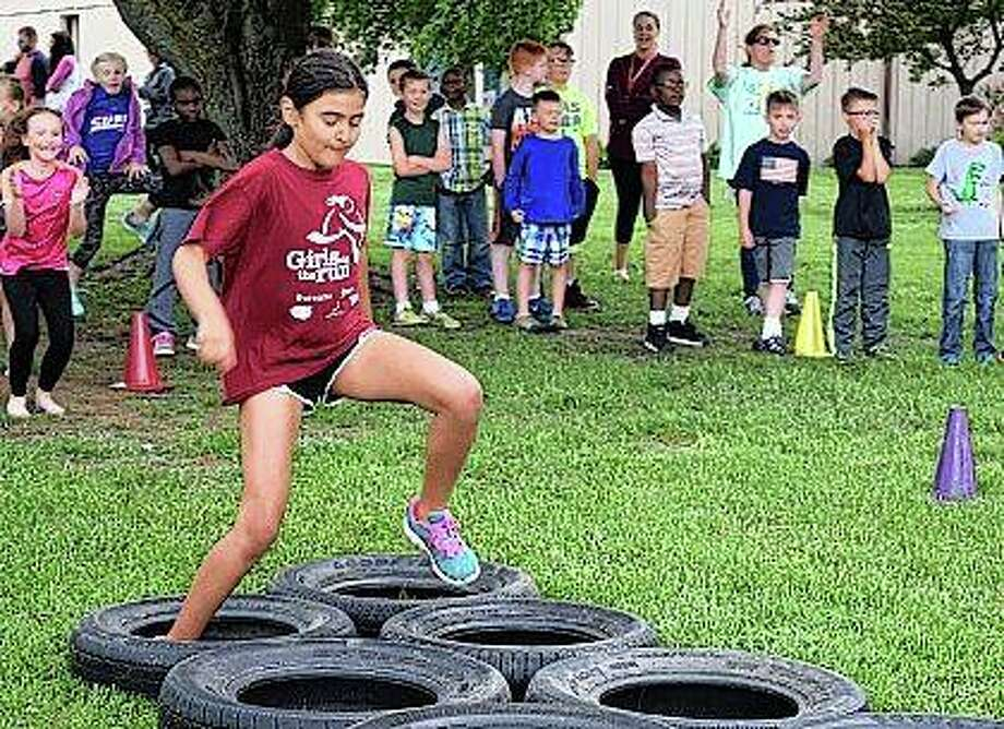 Second-grader Josie Rajaguru runs an obstacle course Wednesday during the Eisenhower Elementary School Fun and Fitness Day. Photo: Samantha McDaniel-Ogletree | Journal-Courier