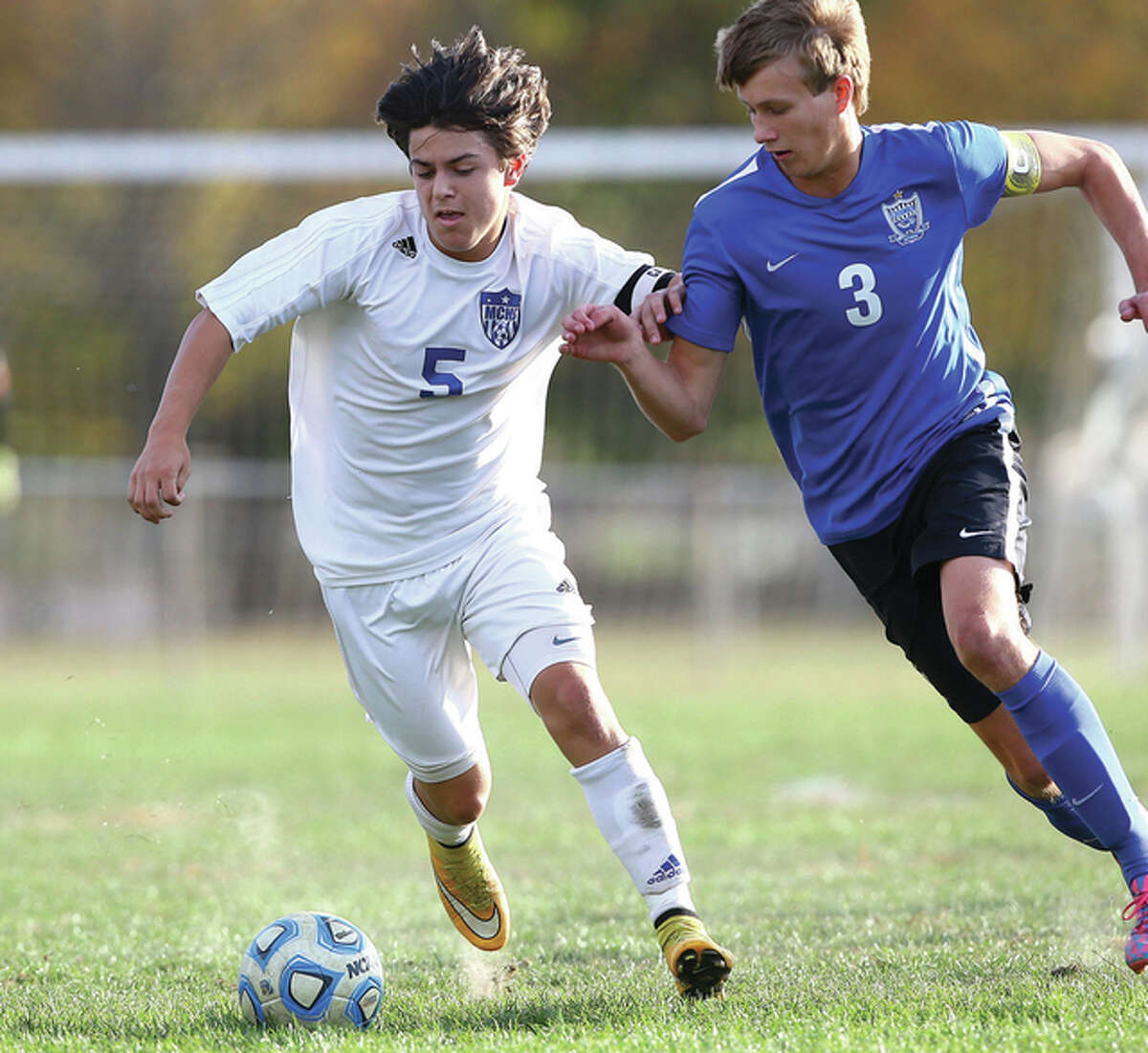 Marquette Explorers forward Zach Weinman, left, scored a pair of goals in his team's 8-0 victory over Roxana Tuesday.