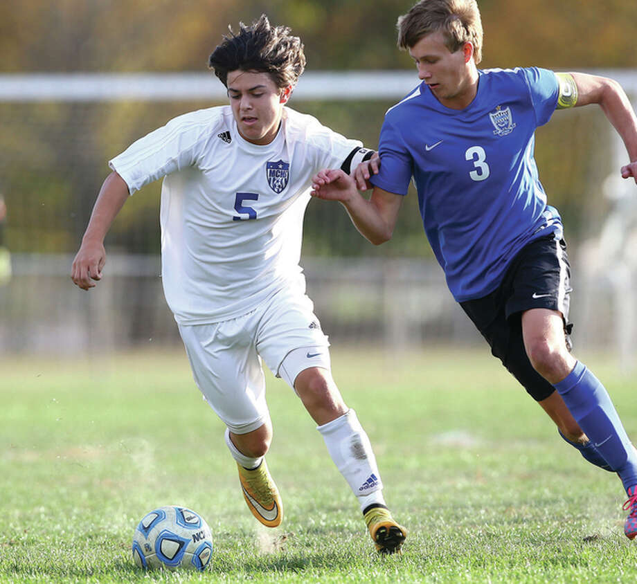 Marquette Explorers forward Zach Weinman, left, scored a pair of goals in his team's 8-0 victory over Roxana Tuesday. Photo: Billy Hurst File Photo | For The Telegraph