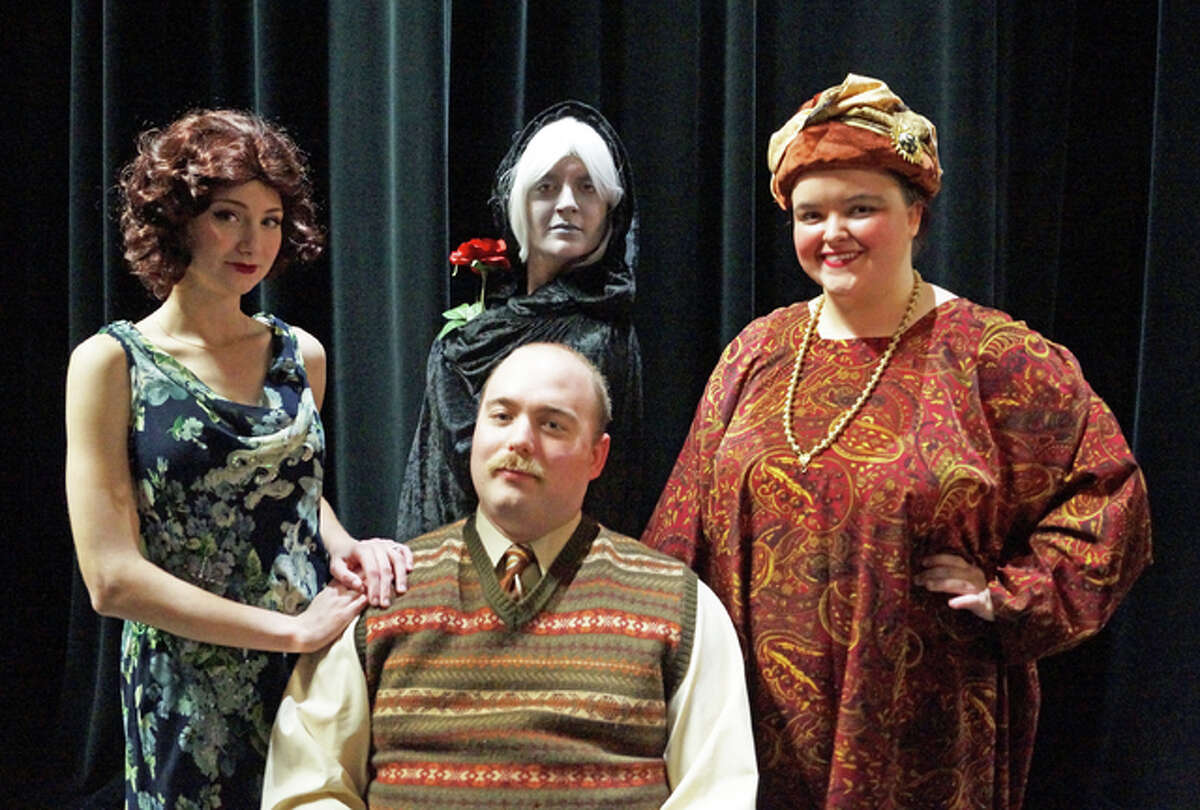 """Southern Illinois University Edwardsville's """"Blithe Spirit"""" features, standing from left, Gracie Sartin as Ruth, Brittney Blackorby as Elvira, Emily Schneider as Madame Arcati, and sitting, Jason McAdams as Charles."""