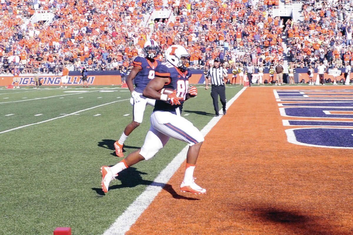 Annslie Johnson of Illinois (80) scores one of his two touchdowns during a game against Western Michigan earlier this season at Memorial Stadium in Champaign.