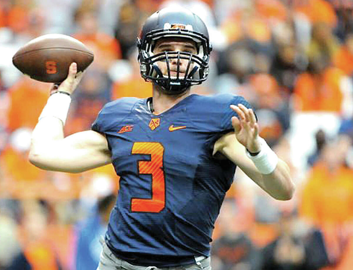 Mitch Kimble throws a pass in a game against Duke during his days as a quarterback for Syracuse.