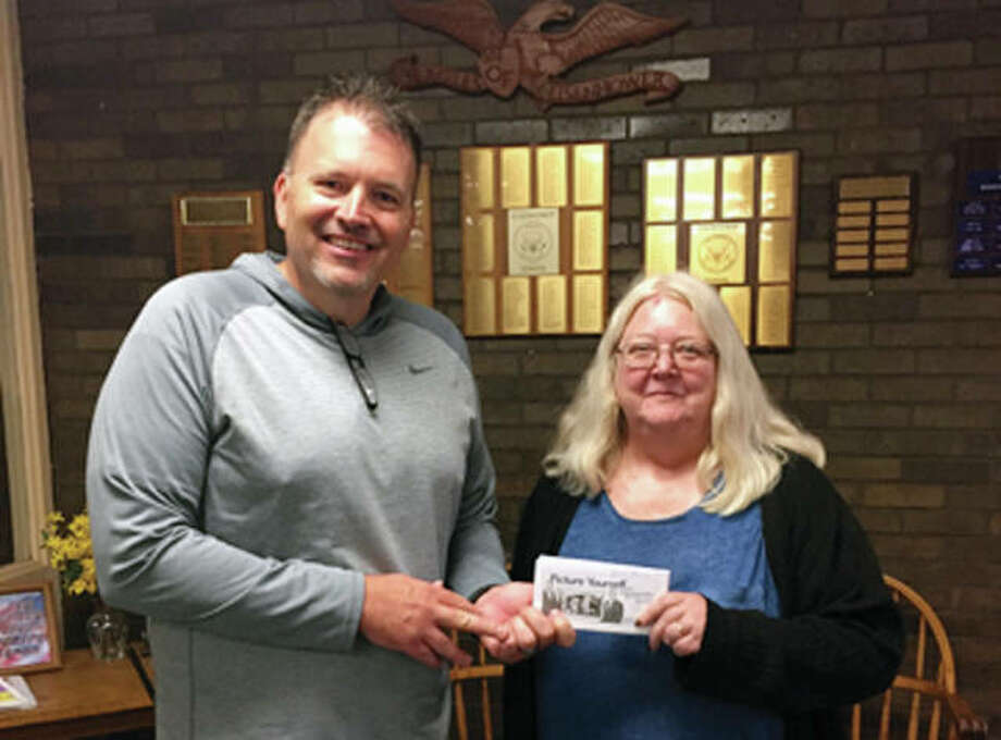 Pilot Club of Jacksonville recently made a donation to its business partner, Eisenhower School. Pilot President Patty Osborne (right) presented a check May 19 to Eisenhower Principal Gary Barlow. Photo: Photo Submitted