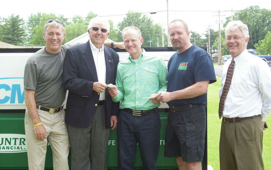 Three area organizations recently received donations representing proceeds from the West Central All-Star Basketball Classic in March at the Jacksonville High School Bowl. Gary Scott (left) of WEAI/WLDS Radio, Rick Pruitt (center) of Country Companies and Mark Whalen (right) of WEAI/WLDS presented $1,000 checks to George Murphy (second from left) of MADD Morgan County and John Hunter of Camp Courage. New Directions Warming and Cooling Center also received a $1,000 donation. Photo: Photo Provided