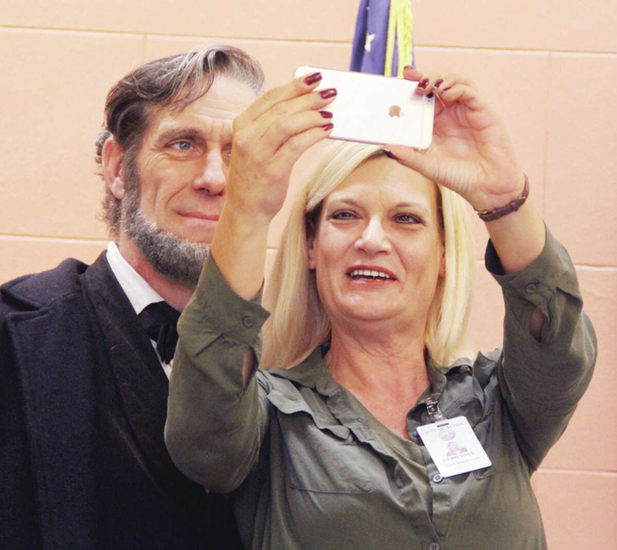 City inspector Dawn Voss takes a selfie with Abraham Lincoln impersonator Randy Duncan, of Carlinville, Wednesday at Alton City Hall. Officials announce the inclusion of Alton as one of six Gateway Cities to the Abraham Lincoln National Heritage Area in Illinois.