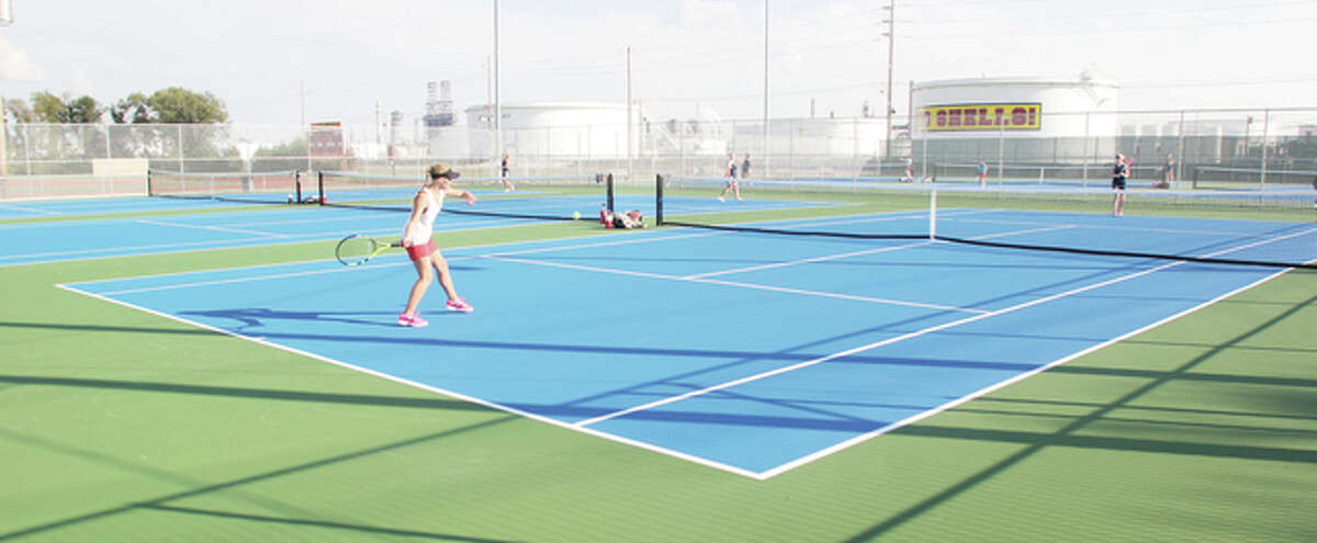 Roxana's Haley Milazzo returns a ball to Emma Melichar of Althoff Catholic High School during a girls tennis match Tuesday. The match was the first played on Roxana's new tennis courts this season.