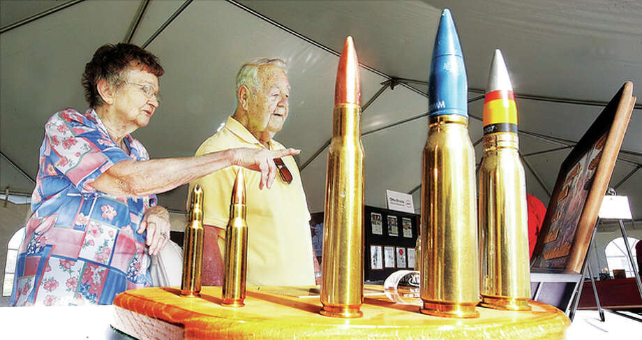 Rita and Floyd Albers, of Bethalto, look over a display of ammunition on display Friday during an open house at Olin Brass on Illinois Route 3 in East Alton, part of the company's celebration of its 100th anniversary. Floyd worked for the brass mill in 1949 and many of his wife's family members have worked for the brass operation or the main Olin plant on the other side of East Alton.