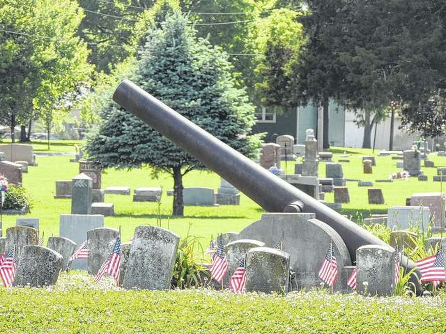 Flags recognize veterans of all wars buried in the military section of Jacksonville East Cemetery. Photo: Jeannie Hemphill | Reader Photo