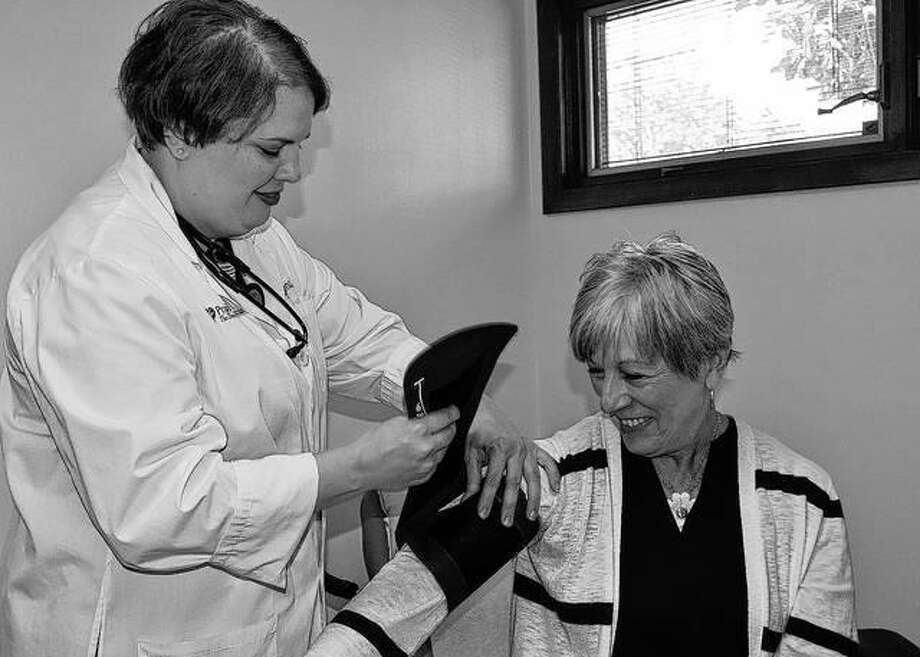 Angela LaFrenz checks Theresa Thompson's blood pressure Tuesday during the opening of Prairie Cardiovascular's multi-specialty clinic in Jacksonville. The clinic is at 1515 W. Walnut St., Building 9. Photo: Samantha McDaniel-Ogletree | Journal-Courier