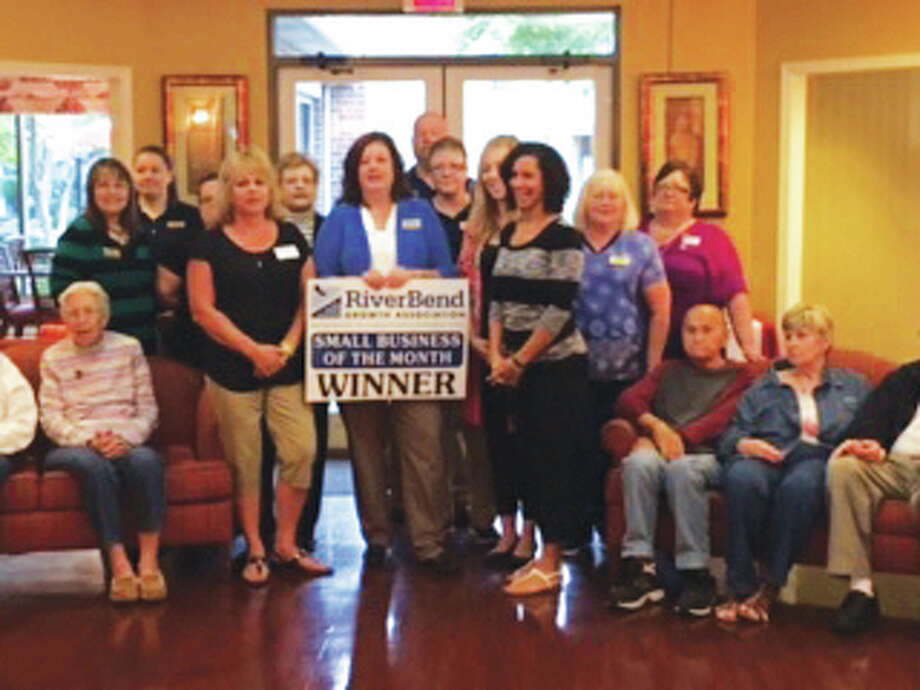 Foxes Grove and RiverBend Growth Association staff pose for a picture at the supportive living community. Foxes Grove was named the association's Small Business of the Month for October.