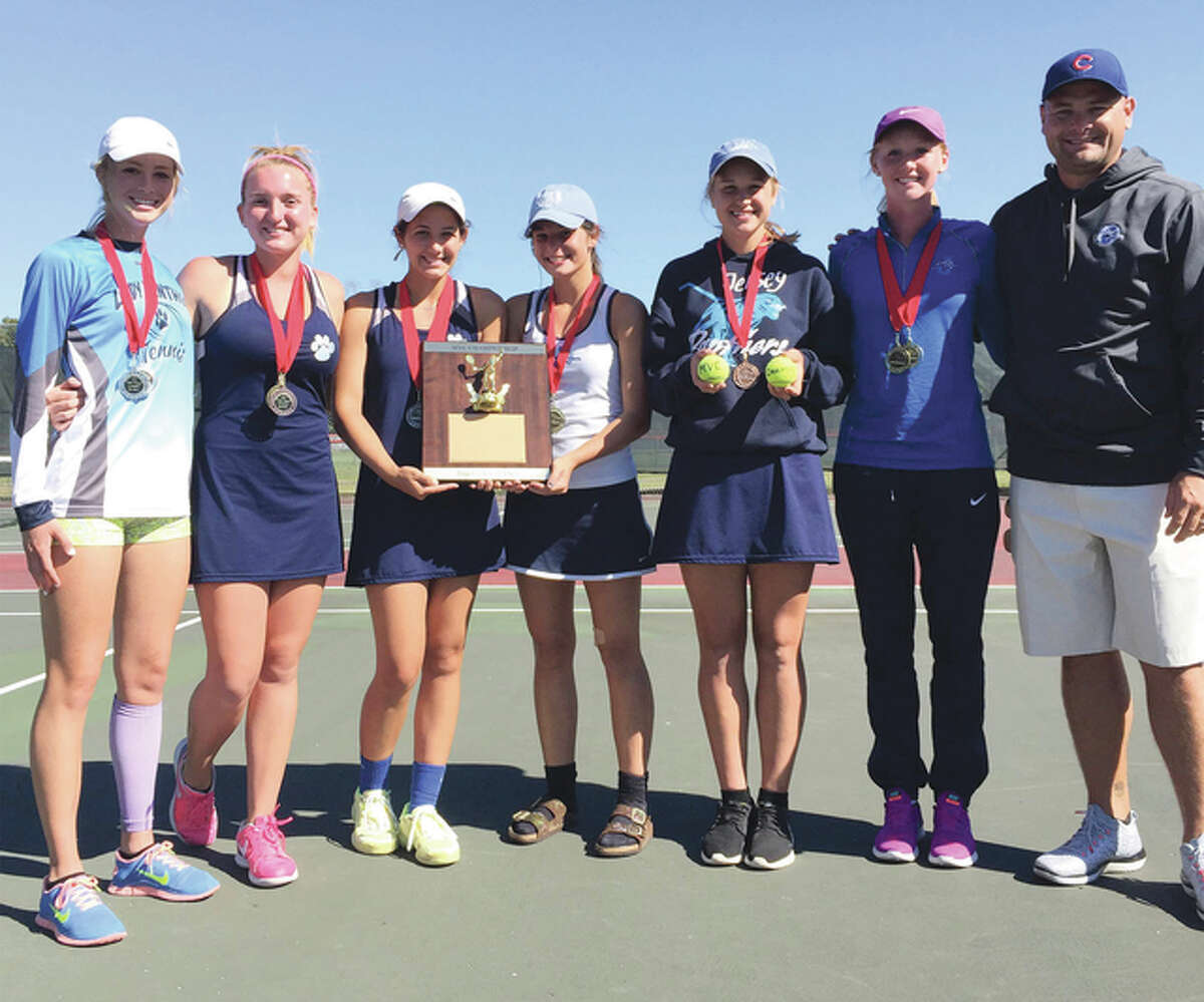 Jersey coach Stote Reeder (far right) and the Panthers (from left) Anne Snyders, Maddie Bugger, Ashton Tewell, Hailea Tepen, Chelsea Maag and Hannah Hudson pose with the championship plaque after winning their first-ever Mississippi Valley Conference girls tennis championship Saturday in Troy.