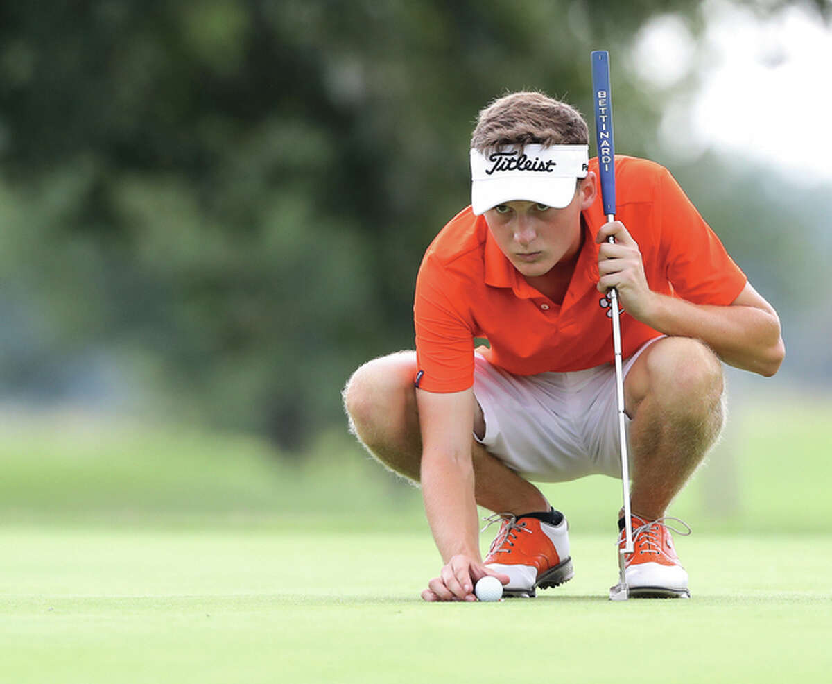 Edwardsville senior Luke Babington places the ball for a putt during the Madison County Tournament on Aug. 18 at Belk Park in Wood River. Babington and the Tigers will play for a return trip to state Monday at the Pekin Class 3A Sectional at Lick Creek golf course.