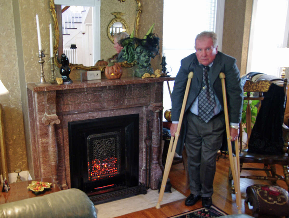 Reenactor John Meehan of Alton portrays the original homeowner of a residence on East Fourth Street, Charles Vanpreter, who was permanently injured in a fall, during the annual Alton Historic House Tour on Sunday.