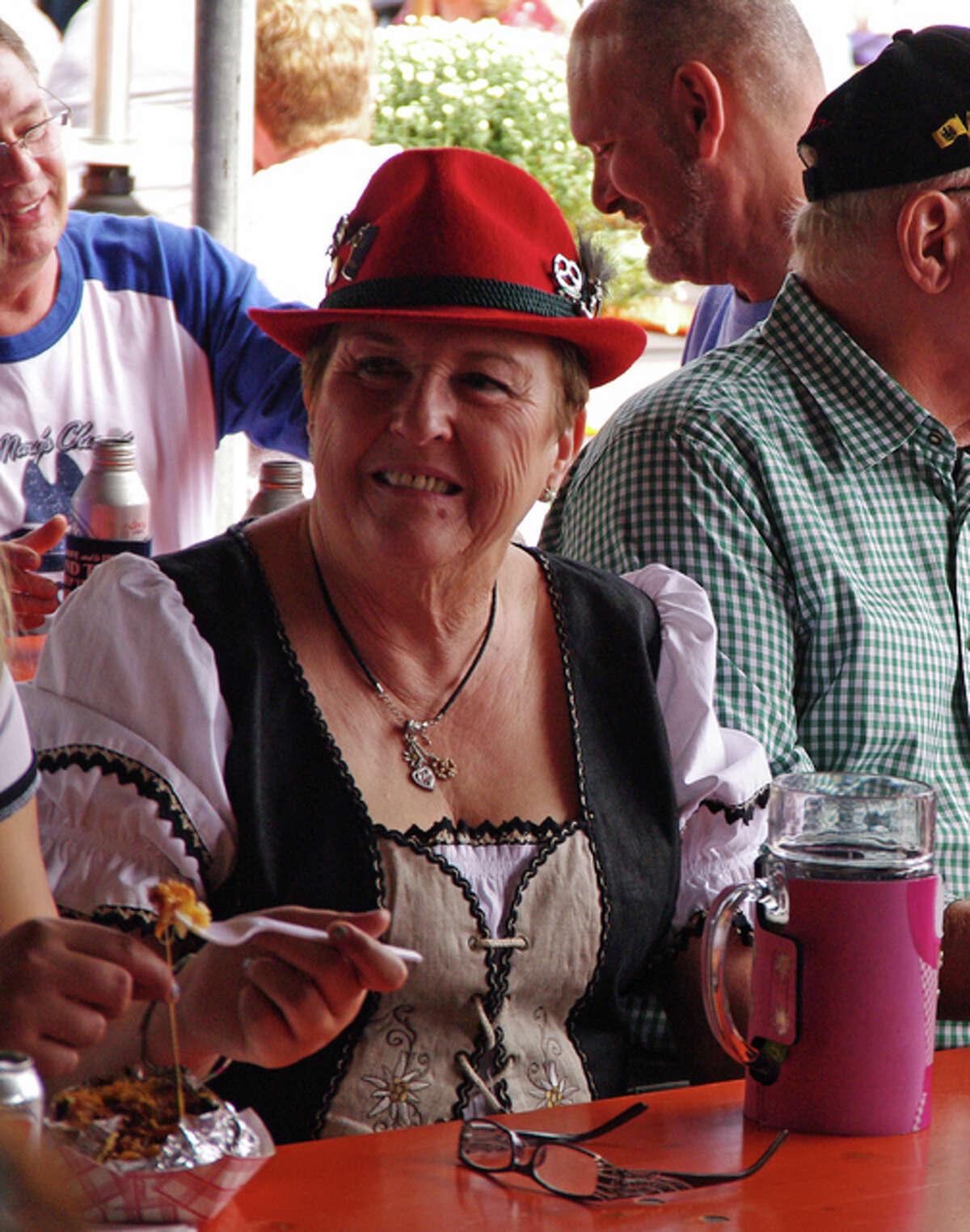 Marilyn Kuhn, of Godfrey, enjoys the St. Mary's Oktoberfest in Alton Sunday.