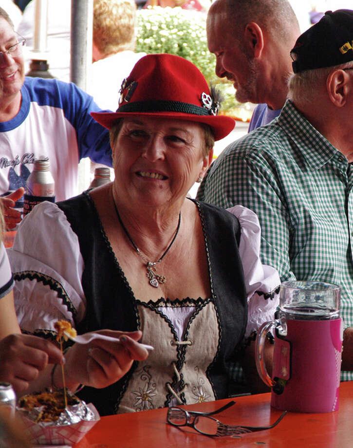 Marilyn Kuhn, of Godfrey, enjoys the St. Mary's Oktoberfest in Alton Sunday. Photo: David Blanchette|For The Telegraph