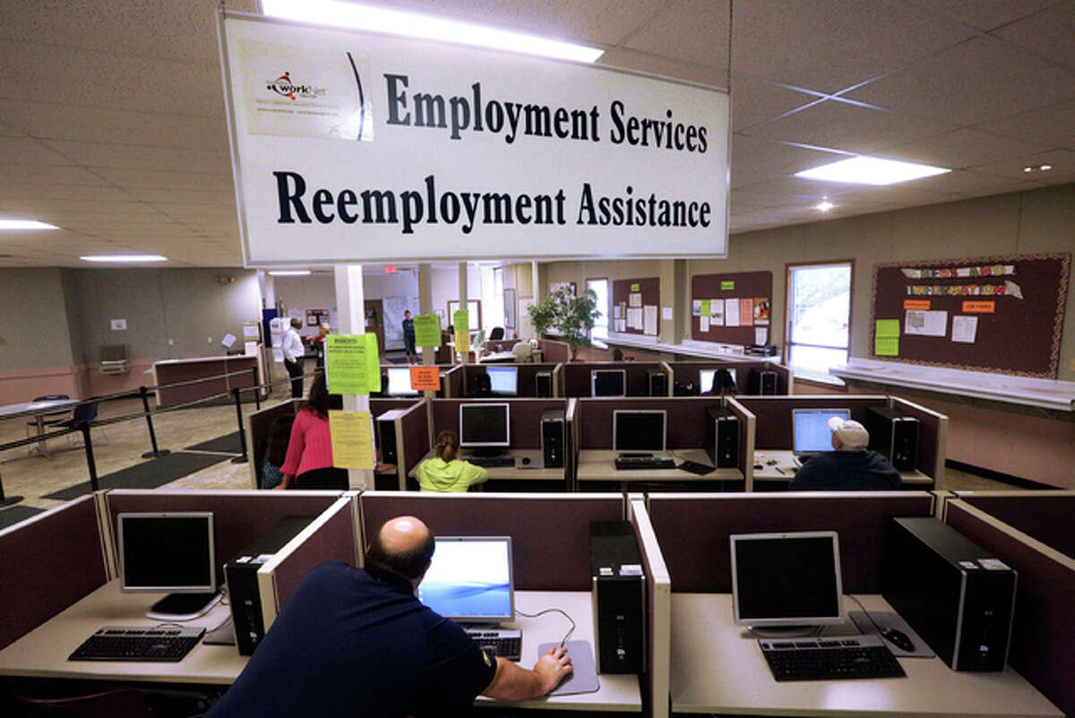 """In this Thursday, Sept. 29, 2016 photo, the Illinois Department of Employment Security office is open in Springfield, Ill. In the past four years, Illinois has paid out more than $700 million in improper unemployment benefits and retrieved only about 37 percent of it, according to an analysis by The Associated Press. That's the worst in the nation, and one reason the state was put on """"high priority"""" status by the U.S. Department of Labor. IDES offers job placement, referrals, unemployment insurance, employment, training programs, career and labor market information. (AP Photo/Seth Perlman)"""