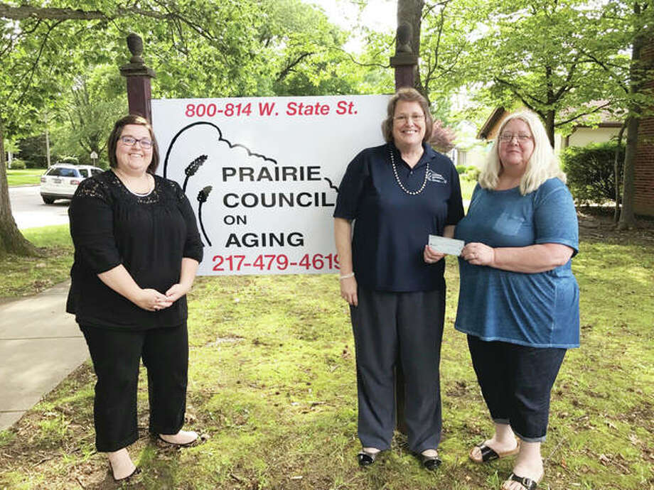 Pilot Club of Jacksonville recently donated $250 to Prairie Council on Aging for its nutrition program. Pilot member Shelle Allen (left) and Pilot Club President Patty Osborne (right) presented the check to PCOA Executive Director Nancy Thorsen. Photo: Photo Provided