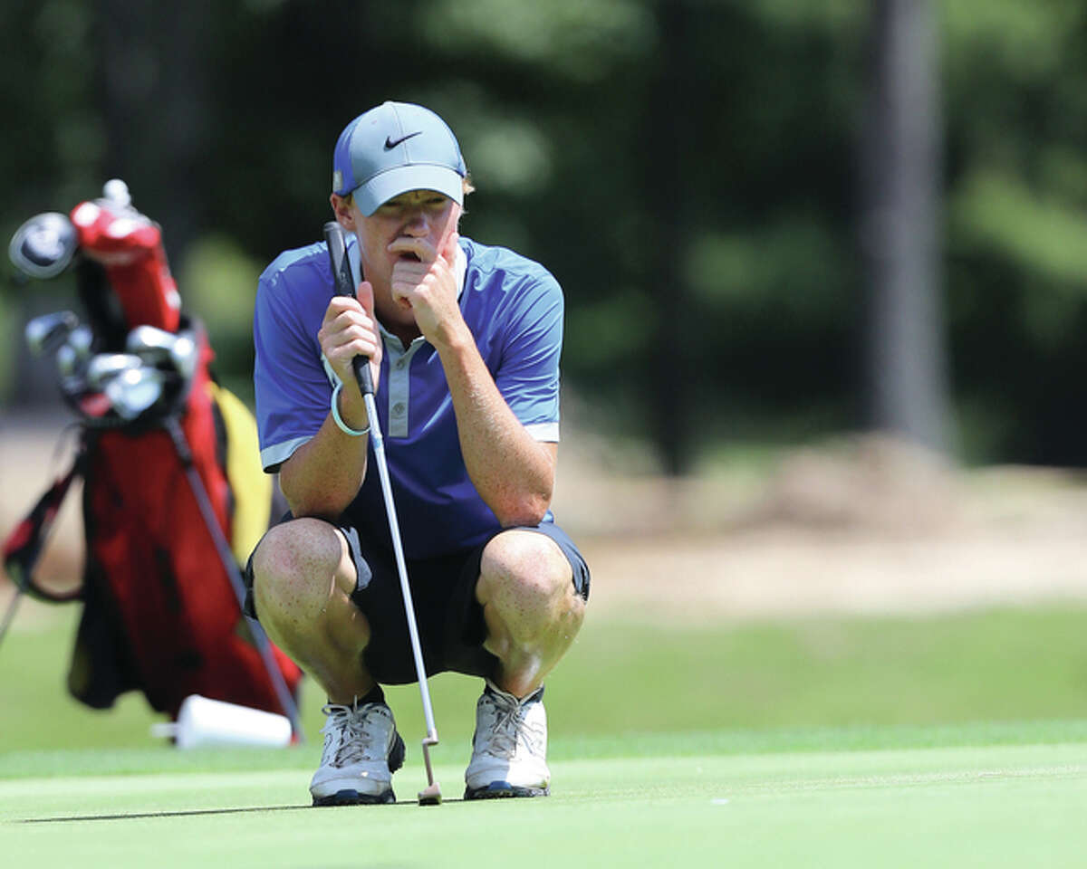 Marquette Catholic senior Michael Holtz, shown lining up a putt during the Madison County Tournament at Belk Park on Aug. 18, shot 72 at the Mattoon Class 2A Sectional on Tuesday to win medalist honors at Mattoon Country Club.