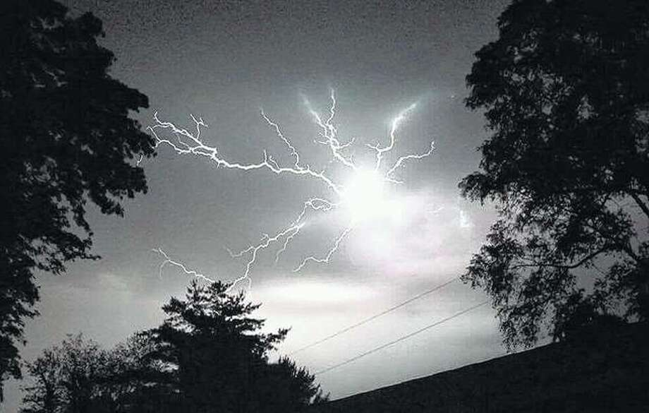 Lightning crashes across the sky as a brief storm moves through Winchester this week. Photo: Elizabeth King | Reader Photo