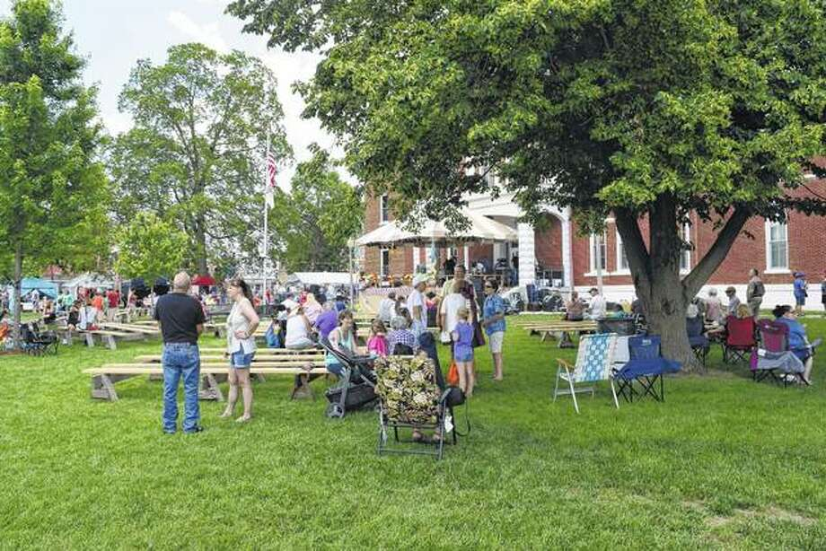 People crowd around the Cass County Courthouse on Saturday in Virginia during the 51st annual Virginia Bar-B-Que. The event ends today. Photo: Greg Olson | Journal-Courier