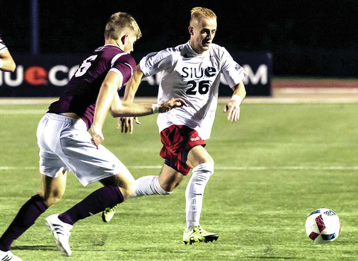 Sue's Greg Solawa (26) dribbles the ball against Missousir State University in college soccer action Tuesday night a Korte Stadium. SIUE won 2-1.