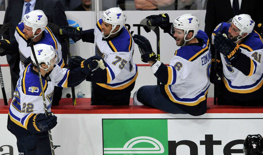 The Blues' Kevin Shattenkirk (22) celebrates with teammates on the bench after scoring a goal in the second period of Wednesday night's season opener against the Chicago Blackhawks in Chicago. Photo: AP