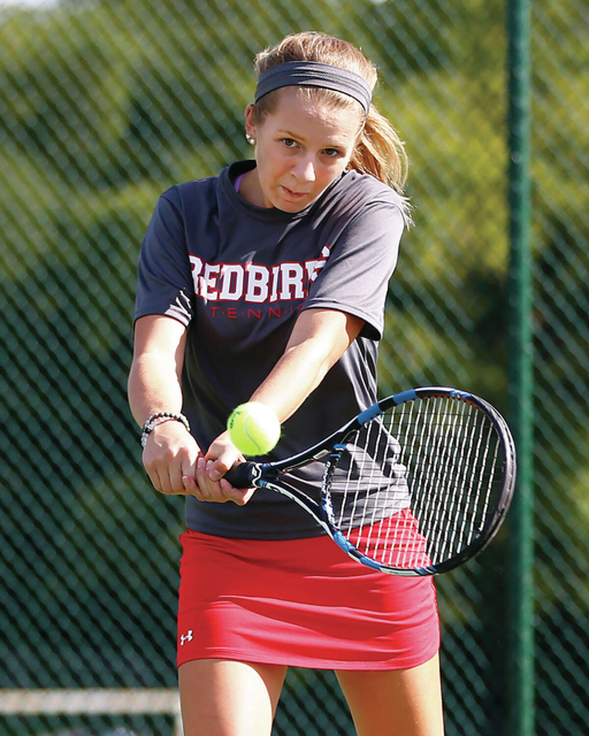 Alton's Abby Fischer, shown hitting a backhand during a match last season, and her Redbirds teammates will be in Belleville on Friday for opening rounds of the two-day Belleville East Class 2A Sectional. Alton and Edwardsville will be competing at East, while the area's smaller schools will play at the Triad Class 1A Sectional in Troy. This is the first season for two-class tennis in Illinois.