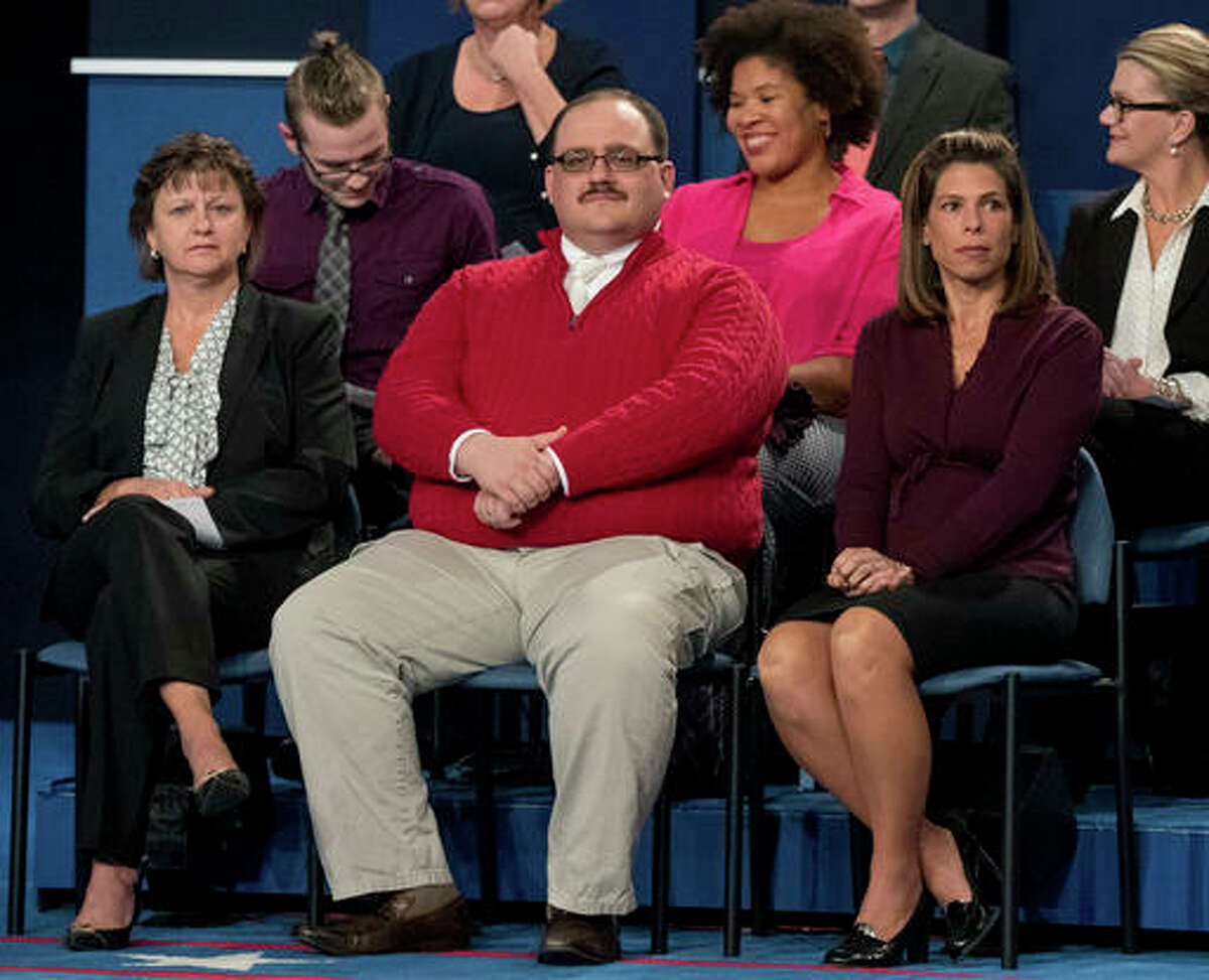 """Kenneth Bone sits in the audience before the start of the second presidential debate at Washington University in St. Louis. Bone answered questions on Reddit late Thursday and early Friday. Bone included his Reddit username in a Twitter post announcing the session. Those who looked up the name found Bone has shared his thoughts on everything from images of a pregnant woman in a bikini to the increased """"sexual satisfaction"""" he found after undergoing a vasectomy."""