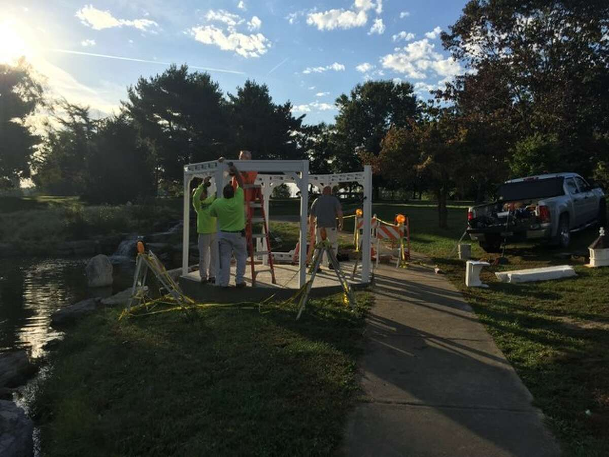 A crew from Jun Construction of Godfrey spent one-and-a-half days this week assembling the gazebo from a kit, as well as putting down a new concrete pad and walkway at the Oriental Garden in Gordon F. Moore Park.