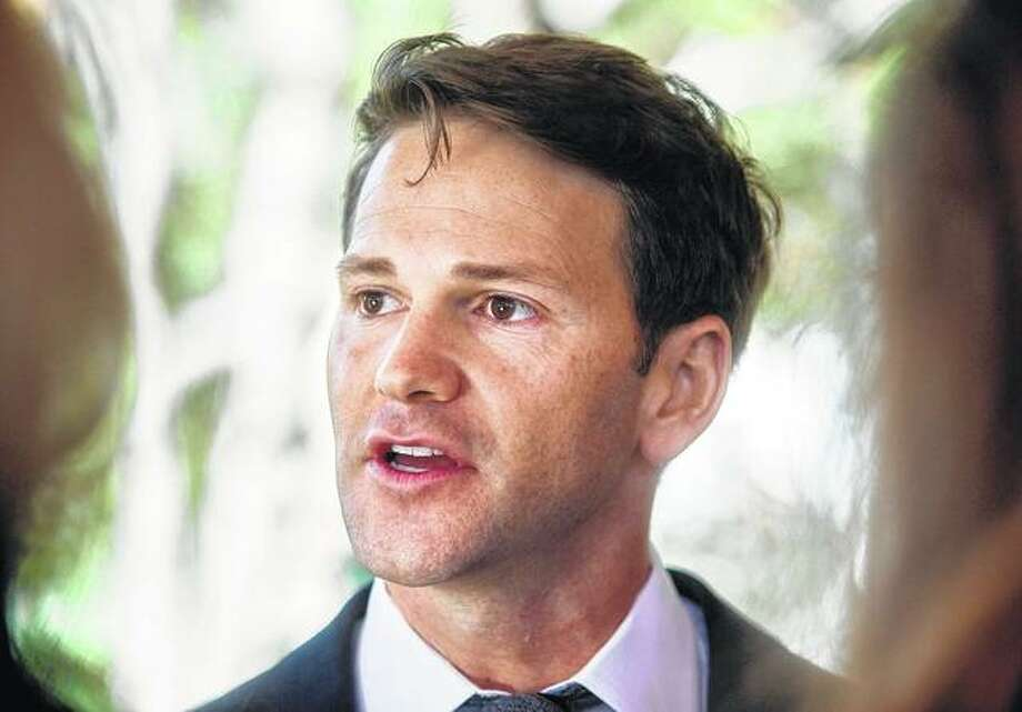 In this Nov. 10, 2016, file photo, former Illinois U.S. Rep. Aaron Schock talks to reporters in Peoria Heights. Federal prosecutors say former U.S. Rep. Aaron Schock shouldn't get more information about a confidential informant in his corruption case. The prosecutors made the argument in a 60-page motion filed Tuesday, April 18. Schock was indicted in 2016 after resigning from Congress. (Matt Dayhoff/Journal Star via AP, File)