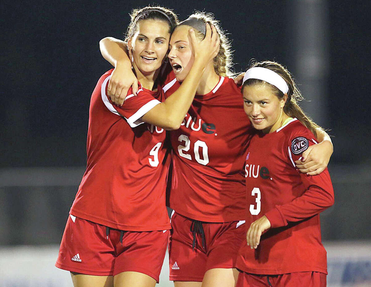 SIUE's Caroline Hoefert, left, Courtney Benning, center and Emily Grahl celebrate Benning's first-half goal Friday night against Austin Peay at Korte Stadium. SIUE won 1-0. Hoefert, a Marquette Catholic High grad, had an assist on the goal.