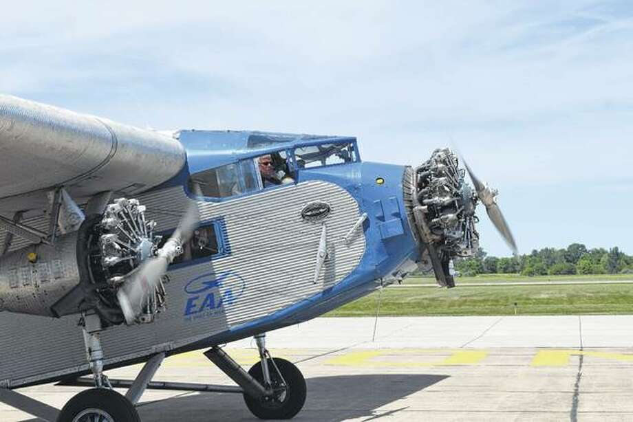 A 1929 Ford TriMotor, the first mass-produced airliner, prepares to take off Thursday from the Jacksonville Municipal Airport. The historic plane is at the airport through Sunday. Photo: Greg Olson | Journal-Courier