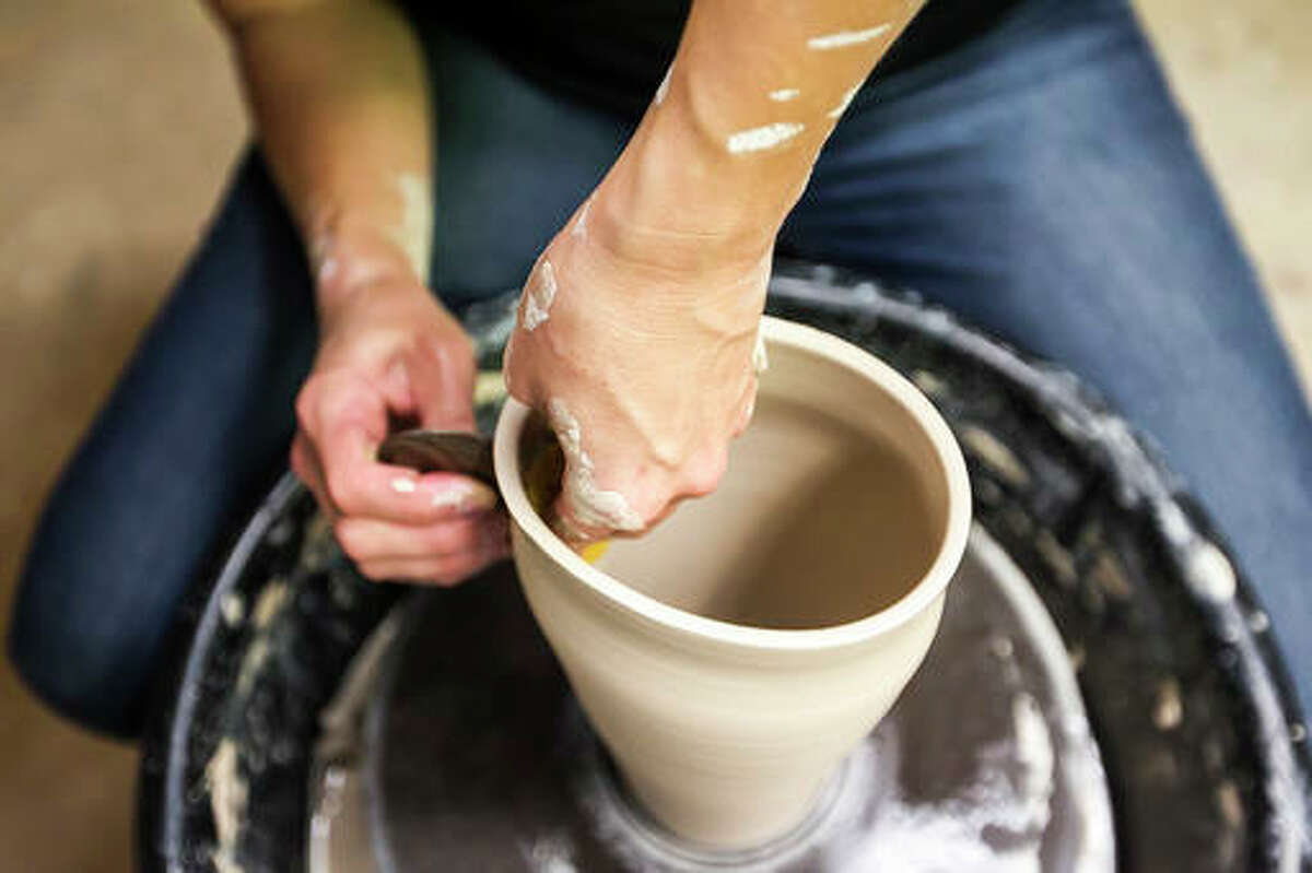 In this Sept. 28, 2016 photo, Lindsay Klix works on a vase at her home studio in Crystal Lake, Ill. Throwing clay on a pottery wheel has been Lindsay's Klix's chosen method of de-stressing since 1998, but it wasn't until Oct. 2115 that she launched her web site Off Your Rocker Potter. Klix spends time throwing clay in the evenings, after her two young daughters have gone to bed and must only run downstairs to fulfill orders, allowing for an impressive 24-hour turnaround time for shipment. (Sarah Nader/Northwest Herald via AP)